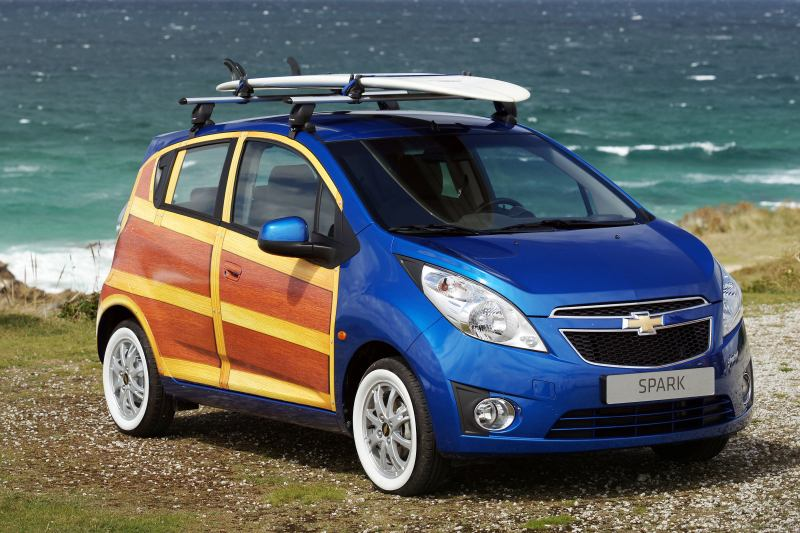 Surfin' USA: The Spark Woody Wagon, a one-off special version of Chevrolet's Spark supermini, is one of a series of 'Art Sparks' created in the past year. It recalls the so-called 'Woodies', large wagons with timber-framed bodywork, that were popular among U.S. surfers back in the late 1950s and early 1960s. (2010-08-12)